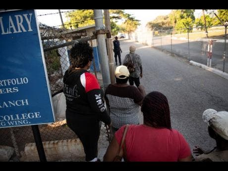 Numerous persons outside Harman Barracks await relatives and friends who were among the 29 deportees from the United Kingdom who returned to Jamaica earlier this month.