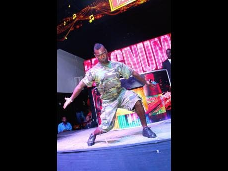 Speng, a Bass Odyssey selector, makes a 'clown face' to excite the crowd during a clash with Richie Feelings in 2014.