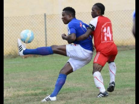 In this file photo from Sunday, September 11, 2016, Stephen 'One Left' Williams (left), then of Portmore United, brings down the ball while being challenged by Andrew Peddlar of Maverley-Hughenden during a Red Stripe Premier League match at the Constant Spring field. Williams has since transferred to Waterhouse.