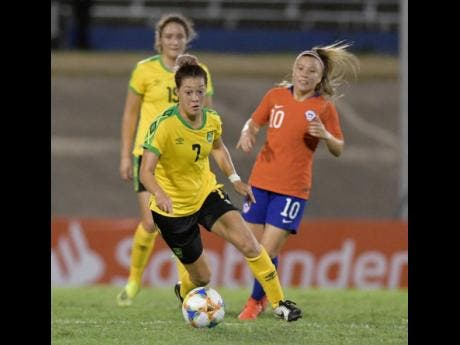 Reggae Girl Chinyelu Asher (centre) is all focus during Jamaica's 1-0 win over Chile in their friendly international at the National Stadium last night.