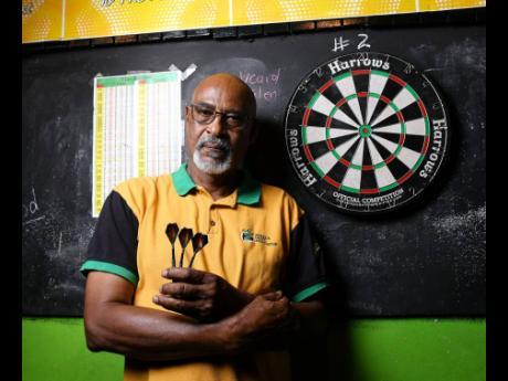 Ricardo MakynJamaica Darts Association President Winston Ferguson