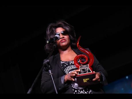 Tanya Stephens accepts her award.