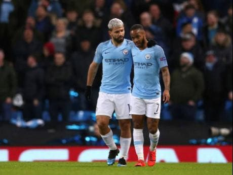 Manchester City's Sergio Aguero (left) celebrates with his teammate Raheem Sterling after scoring his side's second goal during the Champions League round-of-16 second-leg match against Schalke 04 at Etihad stadium in Manchester, England, yesterday.