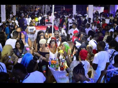 A section of the crowd at Phuket all-white exotic beach party anniversary, held at Fort Clarence, Hellshire, Portmore, recently.