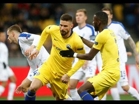 Chelsea's Olivier Giroud celebrates after scoring his side's opening goal during the Europa League round-of-16, second-leg match between Dynamo Kiev and Chelsea at the Olympiyskiy stadium in Kiev, Ukraine, yesterday.