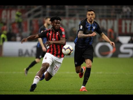 AC Milan's Franck Kessie (left) fights for the ball with Inter Milan's Matias Vecino during a Serie A match between AC Milan and Inter Milan, at the San Siro stadium in Milan, Italy, Sunday, March 17, 2019.