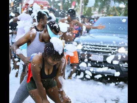 Bacchanal fanatics dance up a storm as they approach the foam pit.