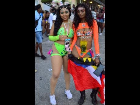 Jamaican Akysia Evans (left) shares a photo with her Antiguan friend, Tiffany Gordon.