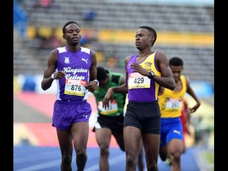 Tyrice Taylor (right) of Enid Bennett High gets to the line ahead of Tarees Rhoden of Kingston College in heat one of the Class One boys 800 metres.