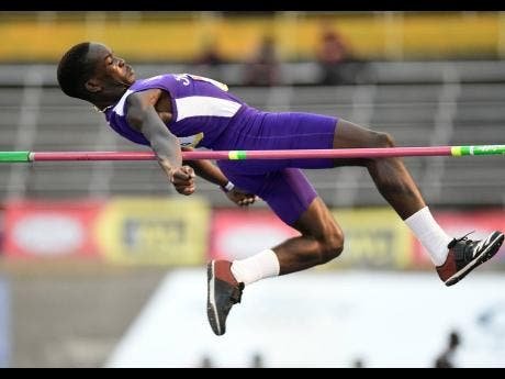 Anthony Willis of Kingston College wins the Class Three boys high jump with a leap of  1.81 metres.