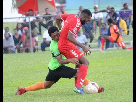 Mitchily Waul (left), then of Tivoli Gardens, puts in a tackle on UWI FC's Fabion McCarthy in a Red Stripe Premier League game at the UWI Mona Bowl in Kingston on Sunday, October 21, 2018. Waul now turns out for Liguanea FC.
