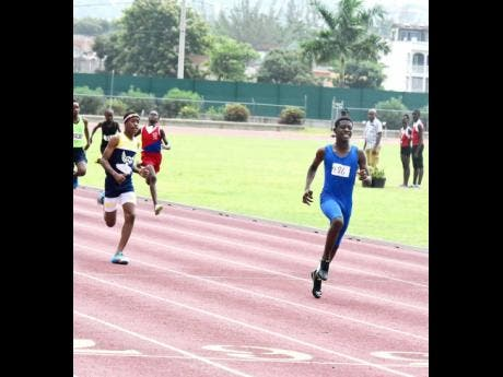 Nataniel Gibbs (right), formerly of Corinaldi Primary School, wins ahead of Rackeem Grizzle, formerly of Barracks Road Primary School, in the 200m final at the Western Primary School Championships at the Montego Bay Sports Complex in Catherine Hall, St James last June. File