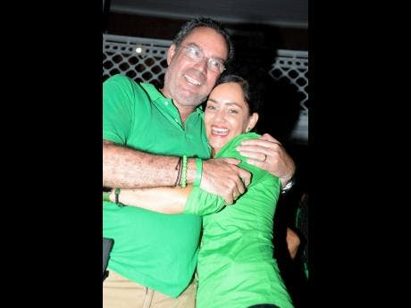 Successful candidate for Portland Eastern Ann-Marie Vaz gets a hug from husband Daryl, JLP MP for Portland Western, at her victory celebration last night.