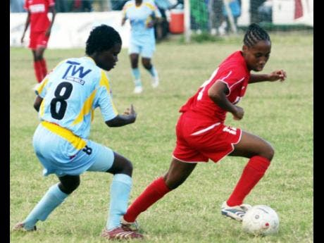 In this file photo on January 14,2008, Portmore Strikers Sheree Marrow dribbles a ball in a match against Waterhouse FC.