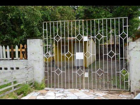 The premises on McIntosh Drive, off Mountain View Avenue, in St Andrew, where a man hanged himself after trying to kill his spouse.