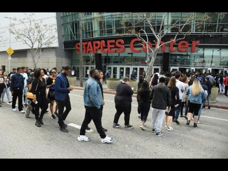 Guests file into the Staples Center to attend the Celebration of Life memorial service for late rapper Nipsey Hussle. (Photo by Chris Pizzello/Invision/AP)