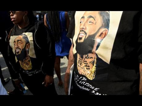 Guests wear T-shirts in tribute to Nipsey Hussle.