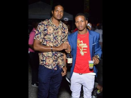 Olympian Jermaine 'Speedy' Gonzales (left) chills with his friend, Kritical, at D'Angel's birthday celebrations at Lip Stick Parking Lot, Bayside, Portmore, St Catherine, last Friday.