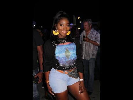Latoya Malcolm gives the brightest smile as she poses for a frame at Mas Camp last Friday for Bacchanal and Dancehall.
