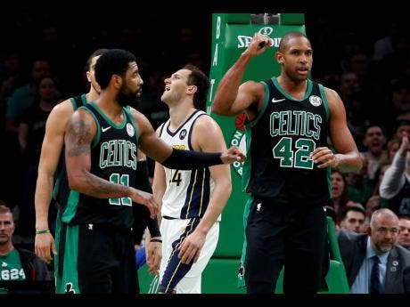 Boston Celtics' Al Horford (42) pumps his fist after being fouled while making a basket by Indiana Pacers' Bojan Bogdanovic (rear) during the second quarter in Game 1 of a first-round NBA basketball play-off series yesterday.