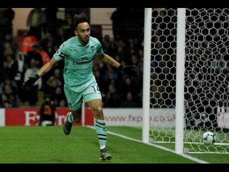 Arsenal's Pierre-Emerick Aubameyang celebrates after scoring the winning goal during their English Premier League match against Watford at Vicarage Road in Watford, England, yesterday.