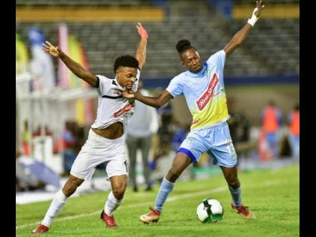 Alex Marshall (left) of Cavalier and Waterhouse's Ricardo Thomas battle for the ball during the Red Stripe Premier League second-leg semi-final between Cavalier and Waterhouse at the National Stadium on Monday, April 15. Waterhouse won 1-0.