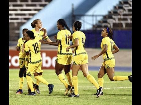 Jamaica's Reggae Girlz celebrate a goal during their 4-1 win over Trinidad and Tobago at the CONCACAF Caribbean Women's Qualifiers at the National Stadium last summer.