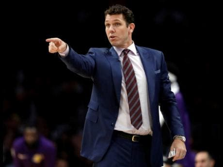 FILE - In this Oct. 20, 2018, file photo, Los Angeles Lakers head coach Luke Walton directs his team during the second half of an NBA basketball game against the Houston Rockets in Los Angeles.