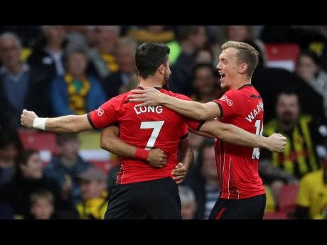 Southampton's Shane Long celebrates scoring his side's goal against Watford during their English Premier League match at Vicarage Road in Watford, London, England, yesterday.