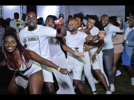 Patrons having a whale of a time at Triple Zero All-White party held in Irish Town, St Andrew recently.