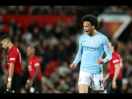 Manchester City's Leroy Sane celebrates after scoring his side's second goal during the English Premier League match against rivals Manchester United at Old Trafford in Manchester, England, yesterday.