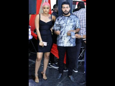 Shevelle (left) lymes with Jared Samuels, Hennessy brand manager.