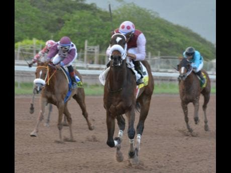 I Am Di One (centre), ridden by Simon Husbands, comes through to win the 1000 Guineas, the 10th race at Caymanas Park on Saturday, April 13, 2019.