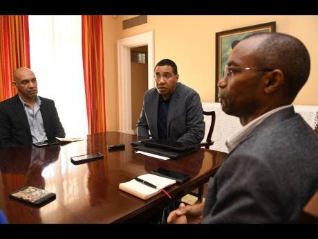The country's top security officials (from left), Commissioner of Police Major General Antony Anderson, Prime Minister Andrew Holness and Major General Rocky Meade, head of the Jamaica Defence Force.
