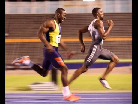 Demish Gaye (right) wins the men's 400m in 45.41 seconds ahead of Rusheen McDonald, who registered 45.50, at the Nike Seniors Link Up Track Meet on Saturday at the National Stadium.