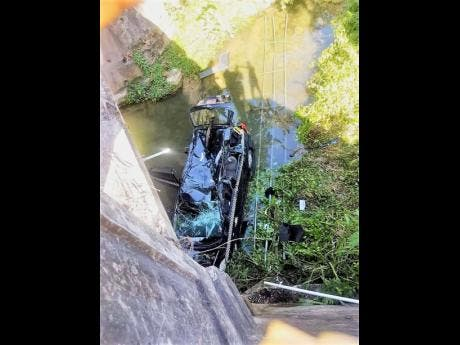 A taxi carrying Edwin Allen High School students plunged into a river yesterday after colliding with another vehicle. Eleven students were injured.