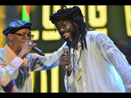 Buju Banton (right) performs with the legendary Beres Hammond at the Long Walk to Freedom concert in March.