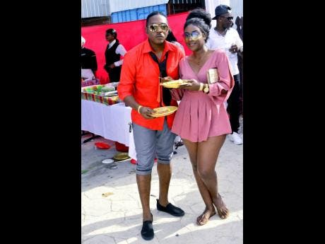 MC Fresh from New Star Entertainment (left) hangs out with a female friend.