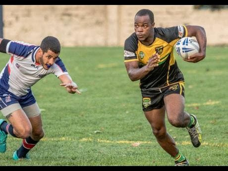 Jamaica Rugby Warriors player Fabion Turner carries the ball during a recent game against the USA.