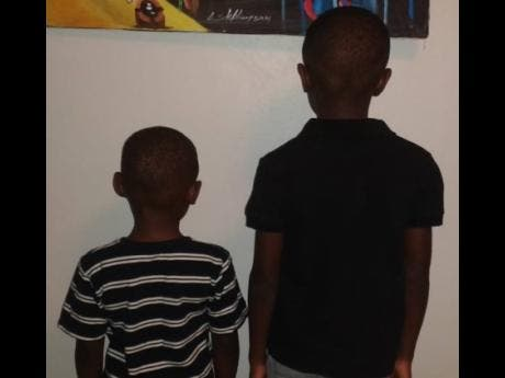 JahDore's four-year-old and eight-year-old Rastafarian stepsons who he alleges were given a haircut after policemen removed them from their home on April 30.
