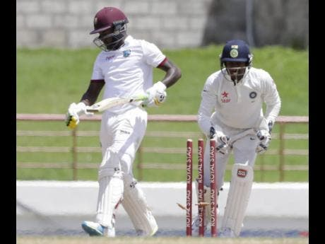 India wicketkeeper Wriddhiman Saha (right) stumps Windies batsman Jermaine Blackwood, of Jamaica, during day five of their third Test match at the Daren Sammy Cricket Ground in Gros Islet, St Lucia.