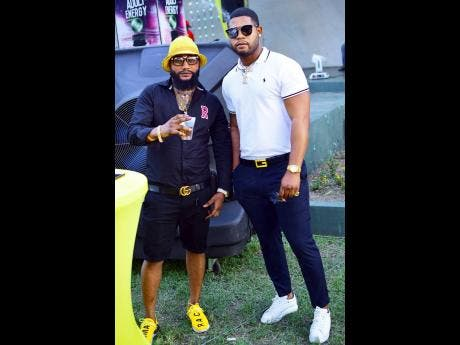 Entrepreneur Ricky Dungatown (left) hangs out with friend Top Man.