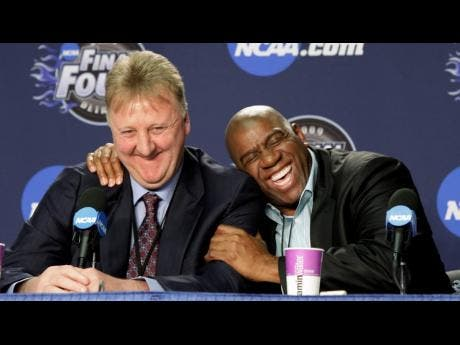 In this Monday, April 6, 2009 file photo, former NBA players Earvin 'Magic' Johnson (right) and Larry Bird share a laugh at a news conference before the championship game between Michigan State and North Carolina at the men's NCAA Final Four college basketball tournament in Detroit.