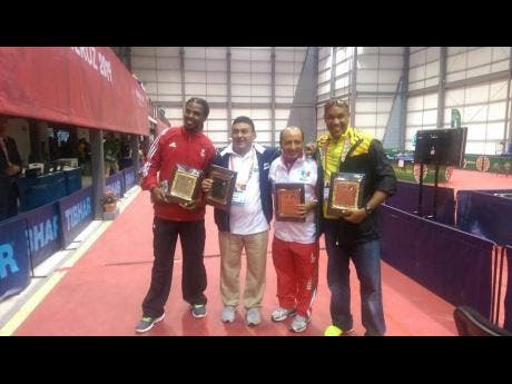 National table tennis player Michael Hyatt (right), pictured with Dexter St Louis (left) of Trinidad and Tobago, Nicaragua's Oscar Molina (second left) and Guillermo Munoz of the Dominican Republic. St Louis passed away in France after a short illness yesterday.