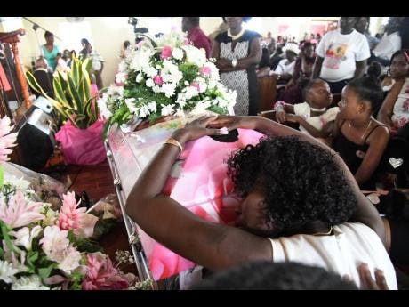 Crystal Service, Shante's mother, clings to the casket as she grieves for her daughter.