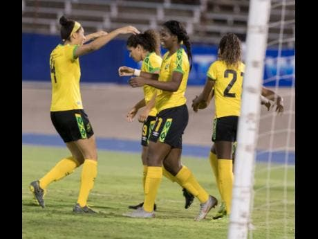 Jamaica's Khadija Shaw (third from left) celebrates after scoring her  second goal with her teammates as the Reggae Girlz beat  Panama 3-1 at the National Stadium yesterday.