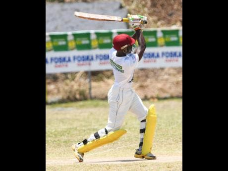 Leronne Tyrell of Rio United plays a shot in his 126-runs innings against St Margaret's Bay in the SDC National Community T20 cricket competition in Buff Bay, Portland.