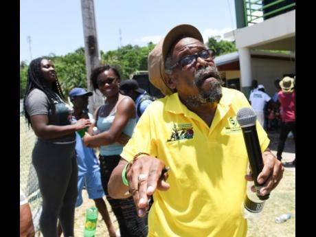 Oren Osbourne, field supervisor for the SDC in Manchester and master of ceremonies for the day, also catching the vibe at the SDC national Community T20 cricket match at Buff Bay, Portland, on Sunday.