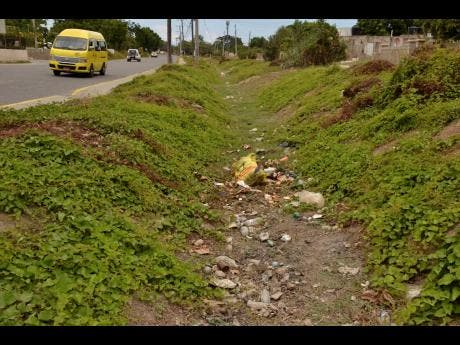 Some residents of Christian Pen are unhappy that persons love to dump their garbage in the areas like this.