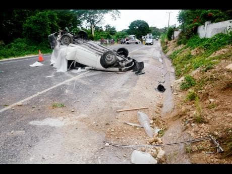 This Nissan AD Wagon motor car crashed along a section of the Ferris main road in Westmoreland on Thursday afternoon, claiming the life of 21-year-old Andre Daley.